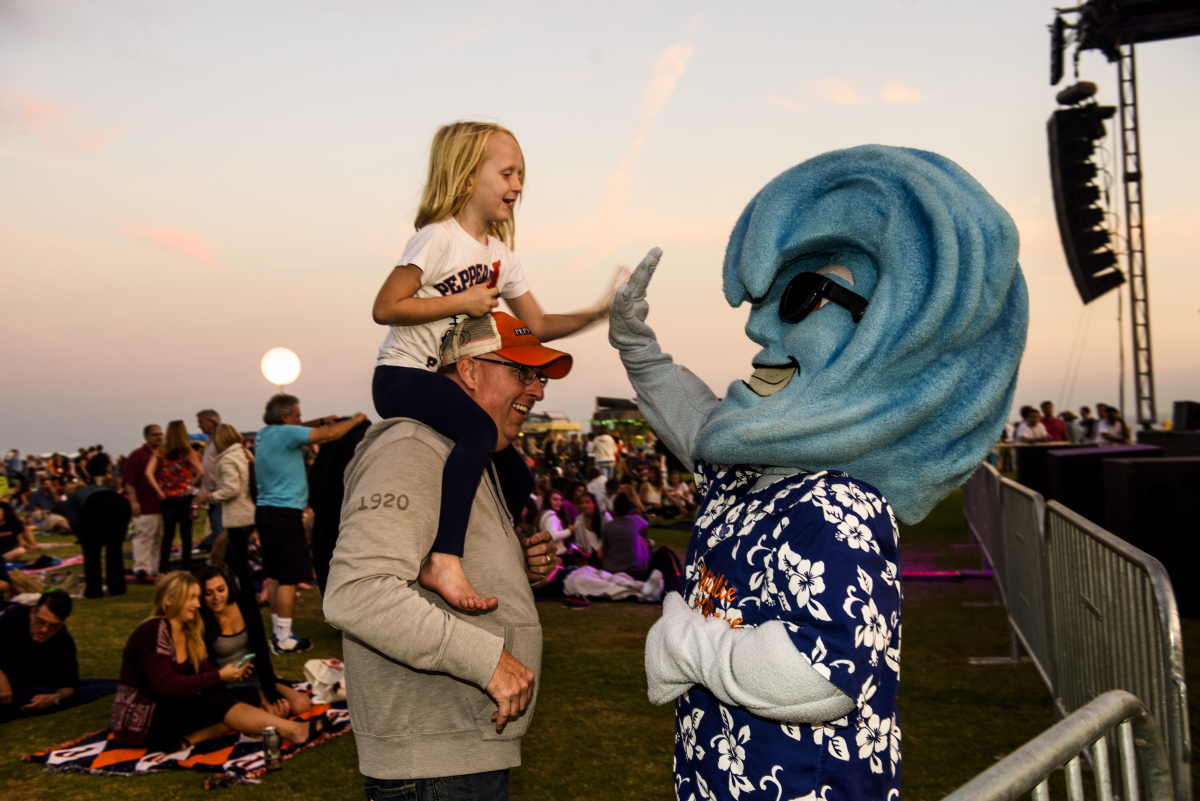 Willie the Wave high-fiving little girl