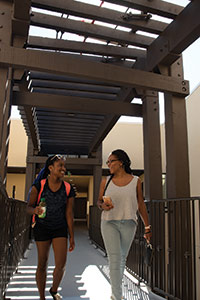 Students walking through Seaside Residence Hall - Pepperdine University