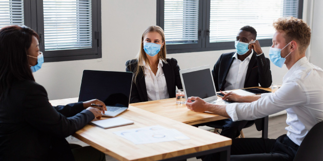 Business people helping tackle the pandemic