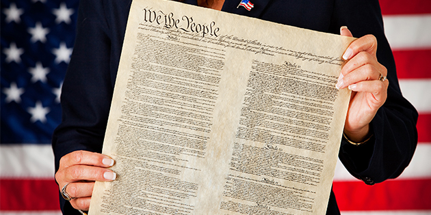 Woman holding the Constitution