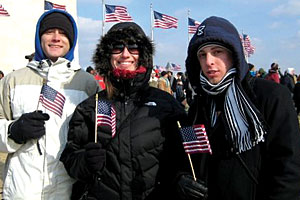 School of Law students Mike Lebow, Mischa Barteau, and Michael Cooper proudly wave the American flag before the Washington Monument.