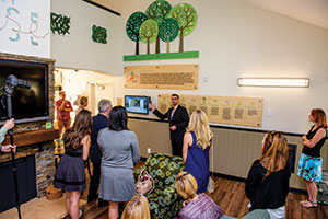 Ben Veenendaal, project director of the Department of Design and Construction, explains the features of the residence hall at the Eden House ribbon cutting.