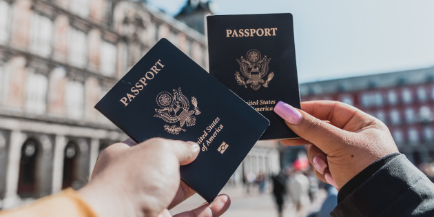 Two students holding a passport