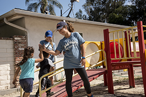 Students play with children after school as part of Step Forward Day
