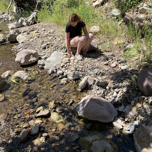 Seaver College student conducting research by a stream in the Santa Monica Mountains