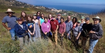 Student researchers standing at their research site with Pepperdine's campus behind them.