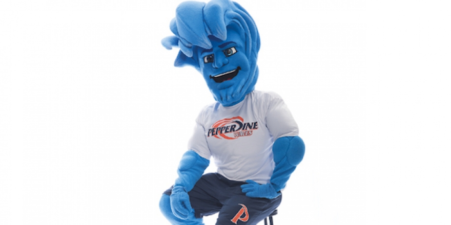 Willie the Wave sitting on a stool