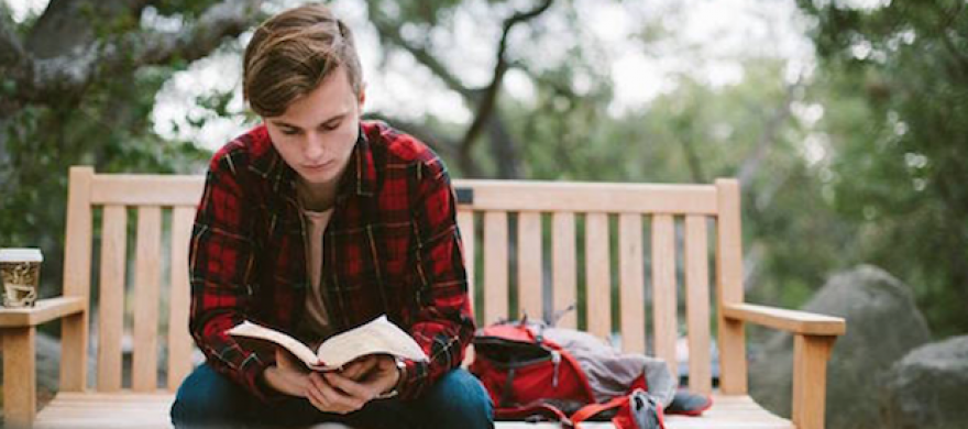 Student reading the Bible - Pepperdine Magazine