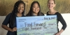 Students in the Philanthropy for Social Change course at Pepperdine University holding novelty check