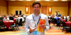 """Graziado Alumnus Paul Martello holding the """"Product of the Year"""" award at the ECRM Baby & Infant Show"""