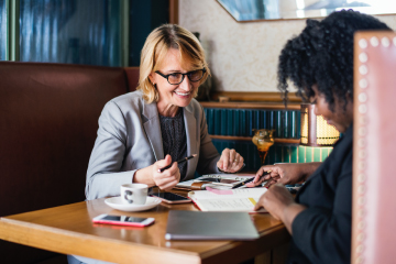 Two women planning out company leadership succession