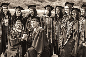 GSEP students grouped together at graduation for a photo