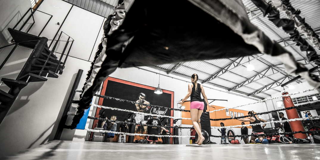 Woman fighter practicing in fighting ring